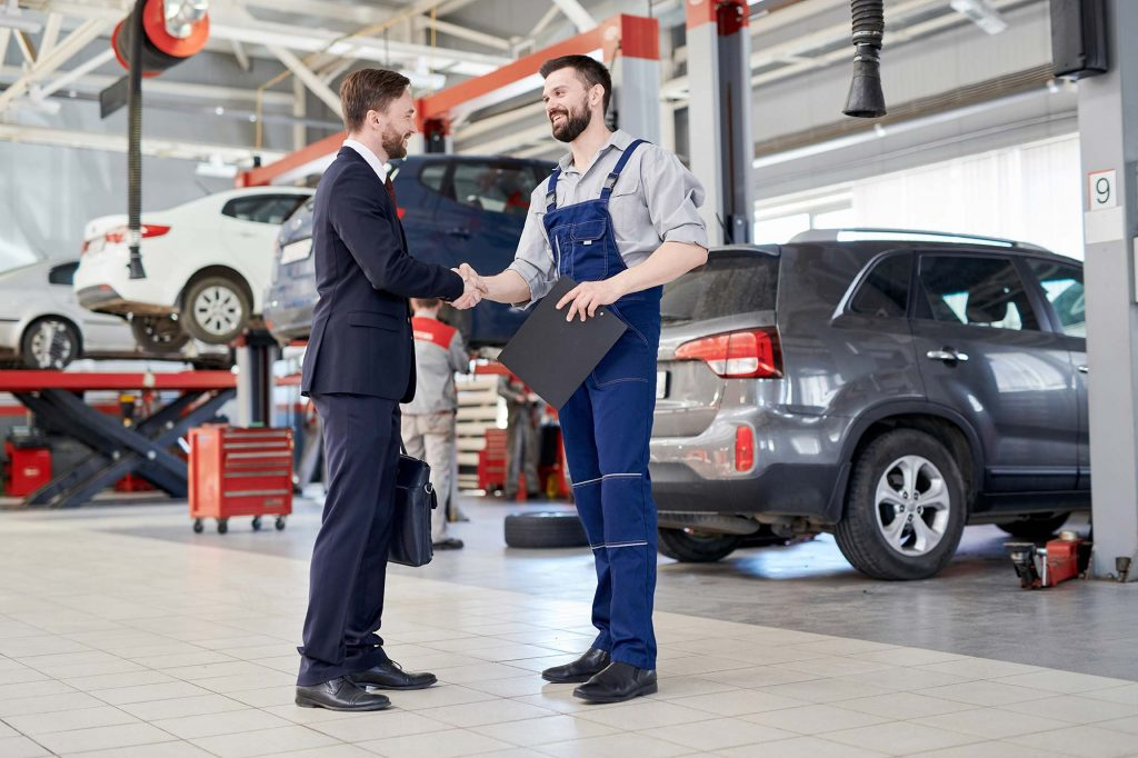 Worker Shaking Hands With Client In Car Service Sh Small 1024x682